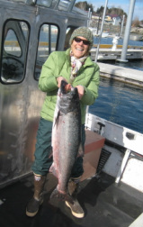 Ila Dillon with king salmon, Seldovia boat harbor, Alaska