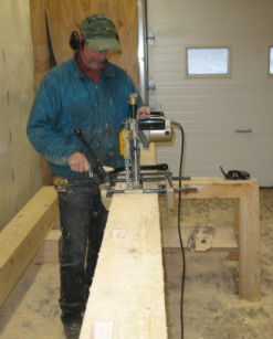 Notching timbers for a custom Timber Frame home, Seldovia, Alaska